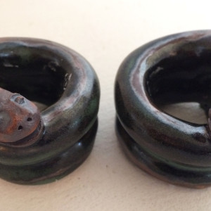 Smiling snakes coiled candle holders by Nell Eakin